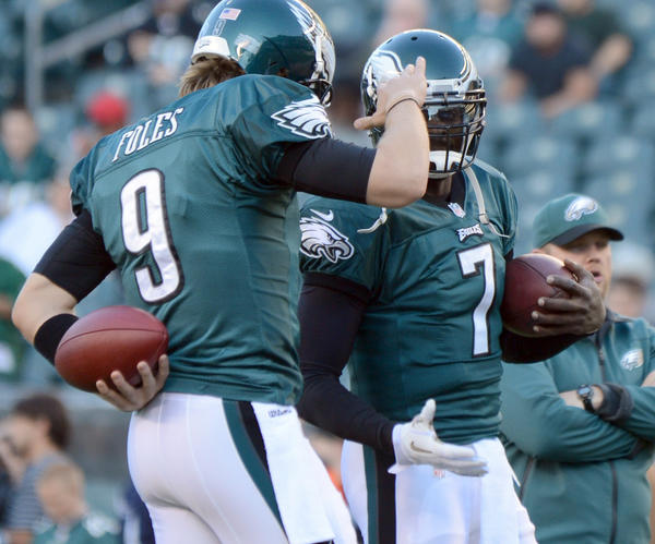 Philadelphia Eagles quarterback Michael Vick (7) and Philadelphia Eagles quarterback Nick Foles (9) talk before the game against the Dallas Cowboys at Lincoln Financial Field