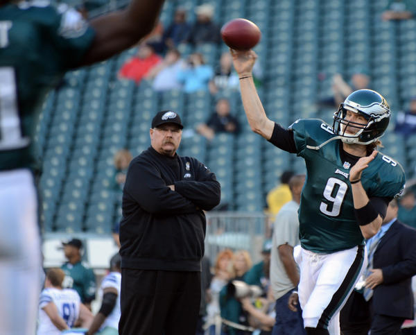 Philadelphia Eagles quarterback Nick Foles (9) passes as Philadelphia Eagles head coach Andy Reid looks on before the game against the Dallas Cowboys at Lincoln Financial Field in Philadelphia on Sunday.