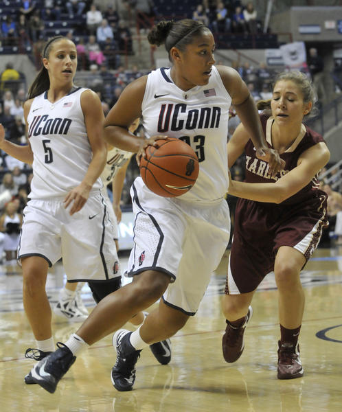 UConn's Kaleena Mosqueda-Lewis drives to the hoop against College of Charleston's Cathryn Hardy at Gampel Pavilion Sunday.