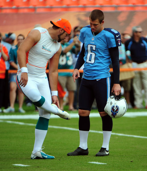 Miami Dolphins Brandon Fields talks with Tennessee Titans Brett Kern prior to the game.