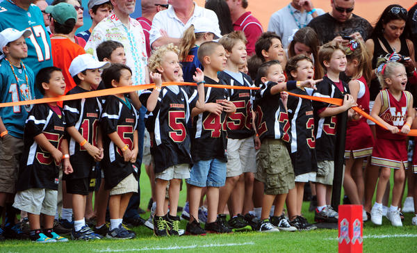 The Weston Warriors pewee football teams watches the Miami Dolphins placekicker Dan Carpenter warmup prior to the game against the Tennessee Titans.