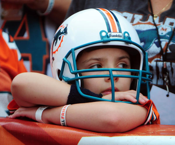 Antonio Soto, age 7, of Pembroke Pines watches the Miami Dolphons warmup prior to the game against the Tennessee Titans.