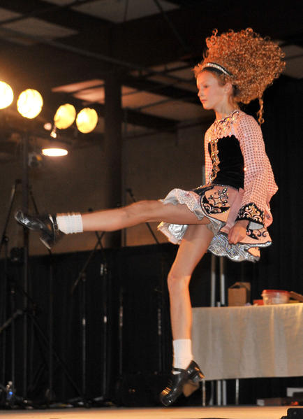 Cori Mark, 11, high kicking with a troupe from the Ryan-Kilcoyne School of Irish Dancing in Bel Air.