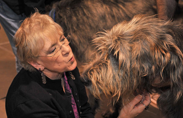 "Nancy Monseaux, of Baltimore, enjoyed meeting ""Boru,"" one of the Irish wolfhounds owned by Rob Maloy of Westminster."