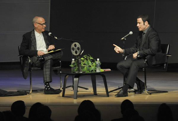 Filmmaker John Waters interviews actor John Travolta at MICA's Brown Center on Saturday for a Maryland Film Festival benefit.