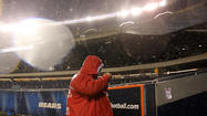 Rain hits Soldier Field tonight. Scott Strazzante, Chicago Tribune