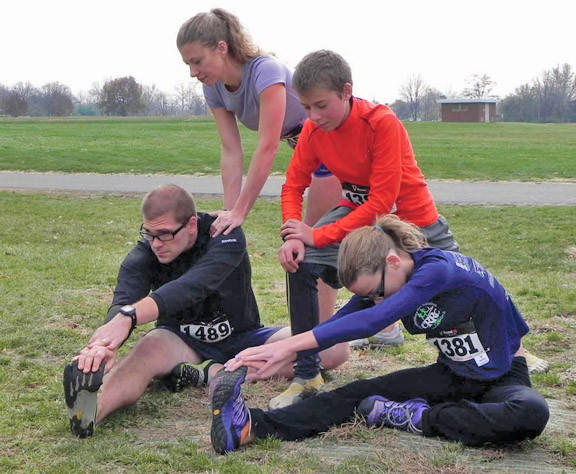 Willow Weir, her husband Ian Weir and their children Jalene Hummer, 13, and Rylan Hummer, 13 stretch before Dash for Drew in Greencastle, Pa., on Saturday.