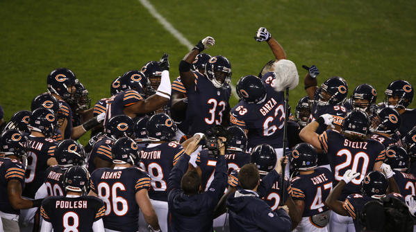Bears cornerback Charles Tillman (33) and center Roberto Garza (63) get fired up before the game.