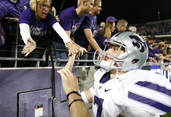 Kansas State quarterback Collin Klein celebrates with fans after a 23-10 victory over Texas Christian on Saturday.