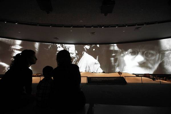 Visitors watch a documentary on the Holocaust in Russia's new museum of Jewish history and culture.