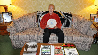 Windber resident Frank Bertino holds a plate that he received when he was inducted into the Pennsylvania Voter Hall of Fame. Bertino voted for the 65th time in Tuesday's presidential election.