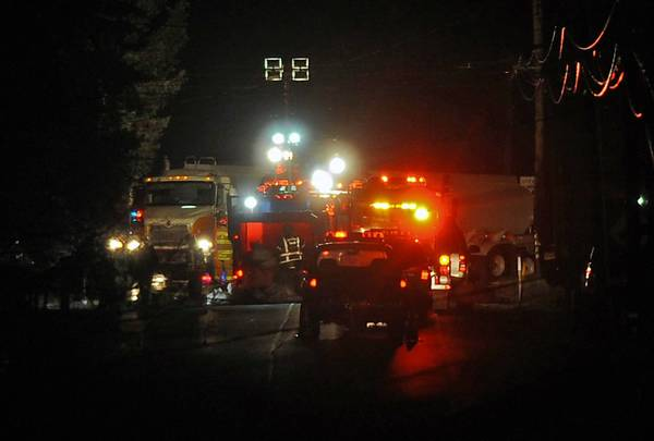 The scene of a fatal accident involving a car and oil tanker truck near the intersection of Buckeye Road and Chestnut Street in Upper Milford Township on Sunday night.