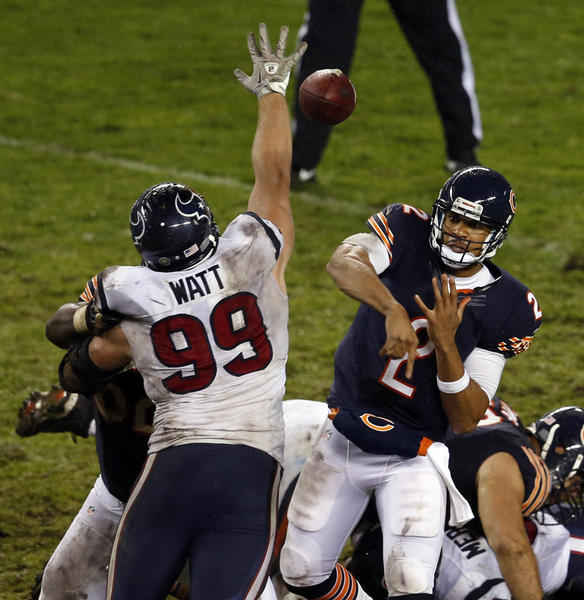 Bears quarterback Jason Campbell throws against Houston Texans defensive end J.J. Watt in the fourth quarter Sunday.