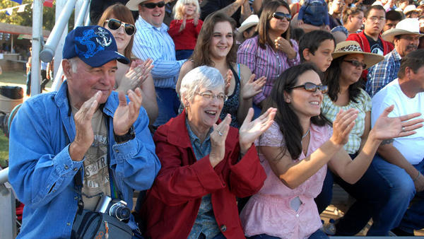 "FROM LEFT: Grandparents Tom Key, Alberta Key and mother Rosa Key react to Joshua ""The Kid"" Key's mutton bustin' performance during the Family Day at the Cattle Call Rodeo in Brawley on Sunday."