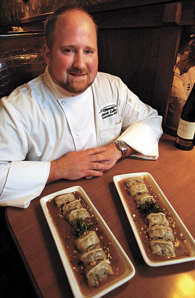 Jacob Collins, the executive chef at Minerva's Restaurant and Bar, shows Drunken Pheasant Dumplings, a dish he serves customers at the Aberdeen restaurant.