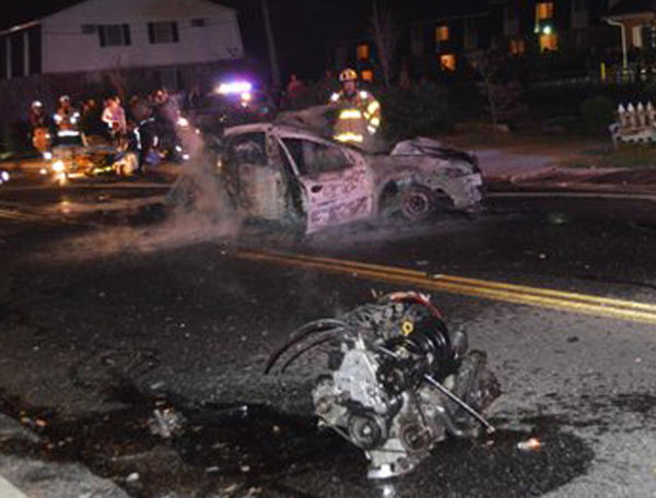 The engine of a car involved in a fiery crash Sunday night on Jefferson Street in Hagerstown can be seen in the foreground of this reader-submitted photo. The driver died Monday morning at a Baltimore hospital.