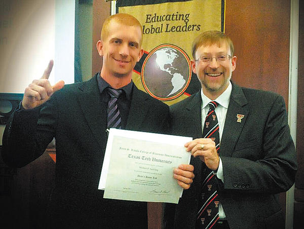 Michael Spalding, left, is shown with Lance Nail, dean of the Rawls Business College at Texas Tech University.