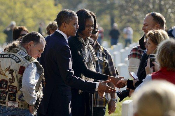 President Obama and First Lady Michelle Obama visit Arlington National Cemetery on Sunday, Veterans Day.