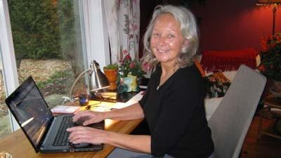 LaNell Aalderink, owner of Up North Travel, sits at her computer ¿ one of her main tools as a travel agent.