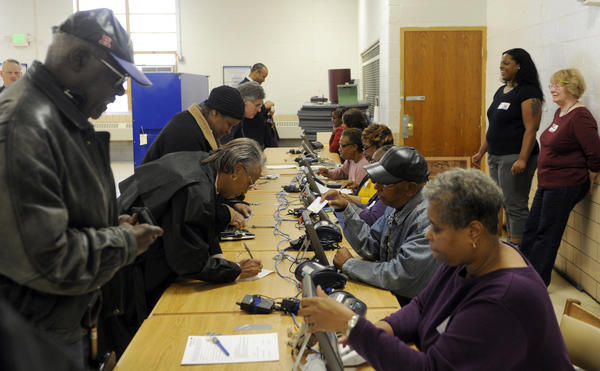Baltimore city voters sign in for early voting at the Public Safety Training Facility on Northern Parkway.