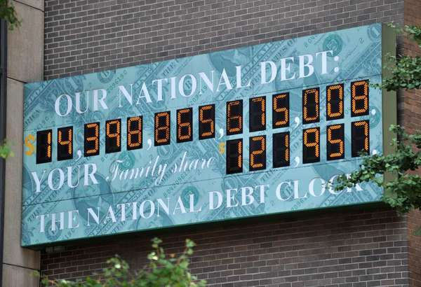The National Debt Clock, a billboard-size digital display showing the increasing U.S. debt, near an office of the Internal Revenue Service on 6th Avenue in New York City back in July.