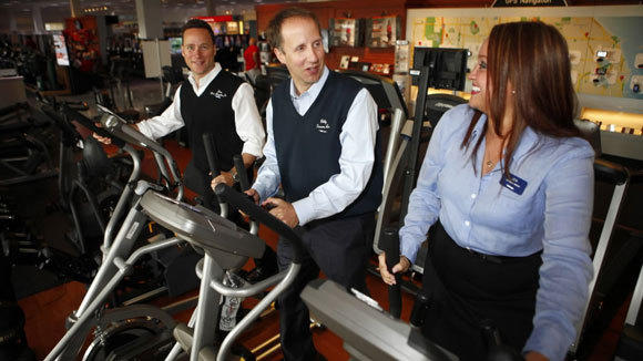 "Human resources manager Jennifer Guzman works out with co-Presidents Bill, center, and Jon Abt at the Glenview Electronics store. ""We're really looking for someone who is honestly just friendly,"" Guzman said of a hiring process largely driven by word-of-mouth referrals from employees and a ""character group interview"" with a small group of managers. ""No matter if it's sales, customer service, human resources -- if we don't think don't they can provide to top level of customer service, then it's not a good fit for us."""