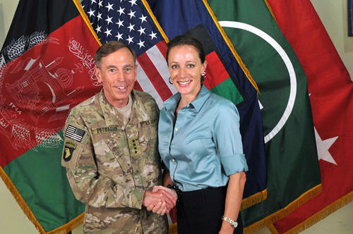 David Petraeus shakes hands with author Paula Broadwell in this 2011 file photo.