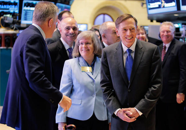 David Petraeus and his wife Holly arrive on the trading floor to ring the opening bell at the New York Stock Exchange in Sept.