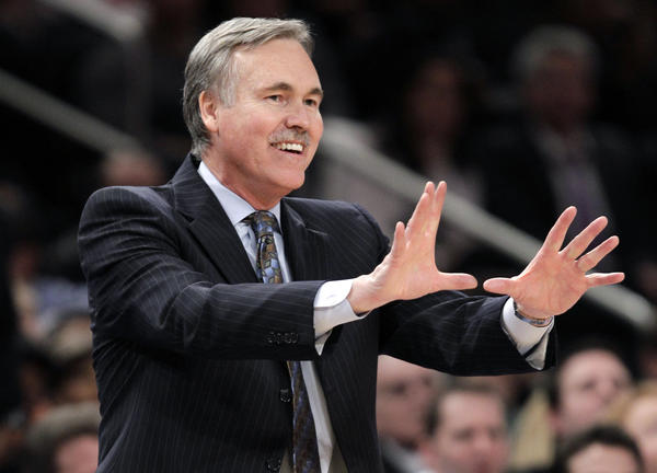 In this Feb. 22, 2012 photo, then-New York Knicks coach Mike D'Antoni gestures in the second half of an NBA basketball game against the Atlanta Hawks in New York. D'Antoni has replaced Mike Brown as the new coach of the Lakers.