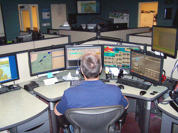 John Barendsen, a Team Leader with Charlevoix-Cheboygan-Emmet Central Dispatch, awaits a 9-1-1- call with five monitors ready to supply necessary information. The Authority recently added technological upgrades, improving not only caller location but also prepare the dispatch for text and picture message from cellular phones.