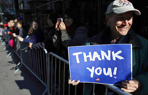 Parade goers show their support and thanks during the 2012 Veterans Day Parade in New York on Nov. 11.