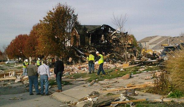 Officials at the scene of the Indianapolis house explosion that killed two over the weekend. Michelle Manchir, Chicago Tribune