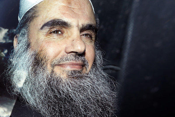 In this Tuesday, April 17, 2012 file photo, Abu Qatada is driven away from a hearing at London's Special Immigration Appeals Commission in London.