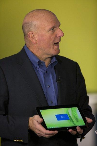 Steve Ballmer, chief executive of Microsoft Corp., holds a Surface tablet.