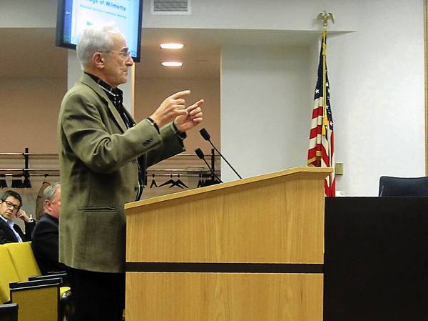 Dennis Chookaszian, who owns the property to the north of the Elmwood Avenue right-of-way, speaks in front of Wilmette's Municipal Services Committee on Nov. 8. He offered to pay the village fair market value for the land and to maintain it as a nature conservancy.