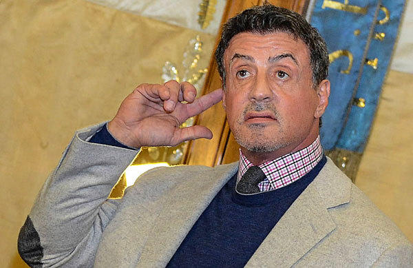 Sylvester Stallone gestures to the paparazzi after receiving the La Lupa Capitolina award from Rome's mayor during his visit to city hall, on Nov. 12. Stallone was in town for the Rome Film Festival.