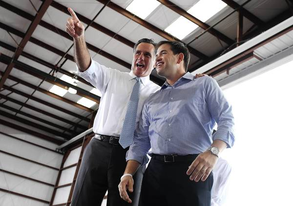 Florida Sen. Marco Rubio, right, with Mitt Romney, is one of the rising stars in the Republican Party.