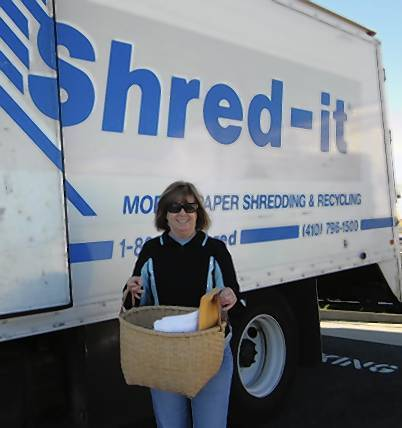 APGFCU member Sharon Moxley recycles paper at credit union's Aberdeen branch.