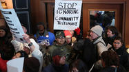 Several hundred protesters marched along Michigan Avenue Monday morning to voice opposition to the school closings plan being put together by Chicago Public Schools.