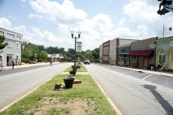 "All the Woodbury storefronts are real Senoia storefronts except for the building housing the Governor's office, which is only a facade built for the show. Additionally, a ""Bank of Woodbury"" sign was added to the facade of another building."