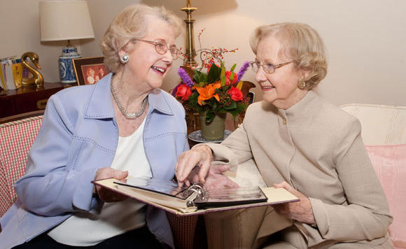 Elinor Broberg, left, and her sister June Bere each have their own independent living apartment at Smith Crossing in Orland Park.