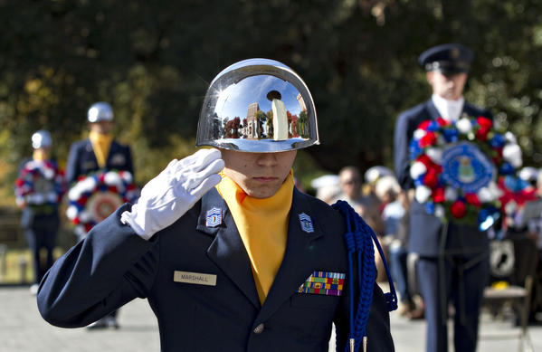 Justin Marshall, Menchville High School USAF JROTC, salutes after laying a wreath during Veterans Day ceremony at Victory Arch in Newport News on Monday, Nov. 12, 2012.