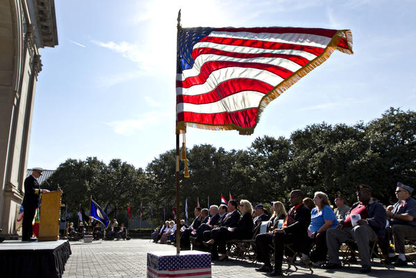 U.S. Navy Captain Michael Stigliz, left, gives a speech during Veterans Day ceremony at Victory Arch in Newport News on Monday, Nov. 12, 2012.