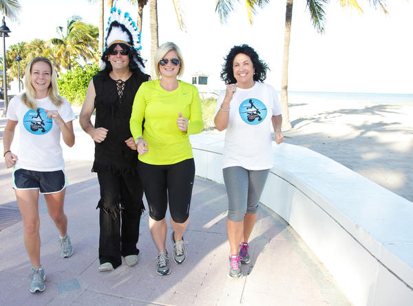 "Christi Rice, left, Elliott Flynn, Meaghan Kirby and Michele Slane warm up while promoting iTRACE Foundation and Emerge Broward's second annual ""Fort Lauderdale Turkey Trot & Paddle,"" which will take place Nov. 22 beginning at DC Alexander Park. The event aims to raise funds and awareness to support healthy living across generations, with an emphasis on childhood obesity."