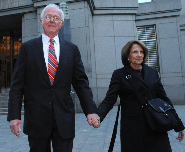 Bruce Bent Sr., left, exits Manhattan federal court with his wife after testifying at his fraud trial in October in New York.