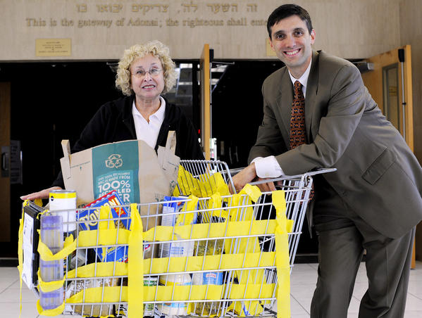 Wilma Turk, left, and Rabbi Edward Bernstein of Temple Torah in Boynton Beach, one of the local synagogues participating in the Jewish Community Food Stamp Challenge. The challenge is a national effort to raise awareness of hunger in American and is backed by Jewish organizations. Those participating are asked to live on a Food Stamp budget of $31.50 per person for one week. That translates to $4.50 per day or $1.50 per meal. For more information, call 561-369-1112.