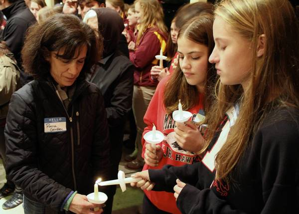 Members of the Student Alliance for Homeless Youth, a group made up of north suburban high school students, take part in its annual candlelight vigil Nov. 11 as part of National Hunger and Homelessness Awareness Week.