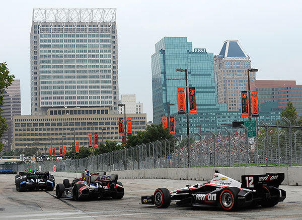 Will Power of Australia, driver of the #12 Verizon Team Penske Chevrolet, races out of turn three during the IZOD IndyCar Series Baltimore Grand Prix on September 2, 2012 in Baltimore, Maryland.