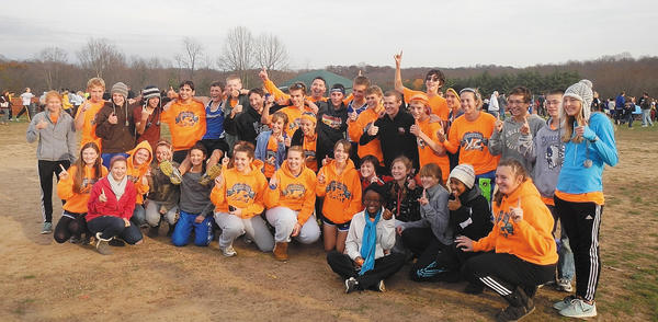 The Boonsboro High School girls and boys cross country teams celebrate their Class 1A state cross country titles Saturday at Hereford High School.