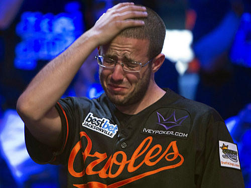 Greg Merson reacts to winning the final hand at the World Series of Poker Main Event